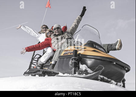 young people on snowmobile (model-released) - Stock Photo