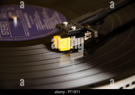 Vinyl record player with focus on turntable cartridge on plate horizontal background photo - Stock Photo
