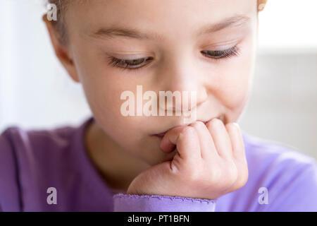 Portrait of pensive little girl, close-up - Stock Photo
