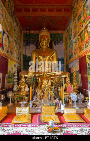 Altar and many golden Buddha statues inside of decorative Wat Mixai (Mixay) ('Temple of Victory') in Vientiane, Laos. - Stock Photo