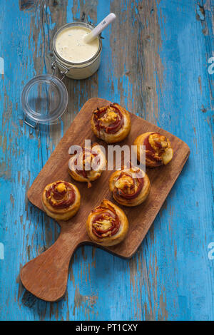Baked puff pastry with ham and cheese - Stock Photo