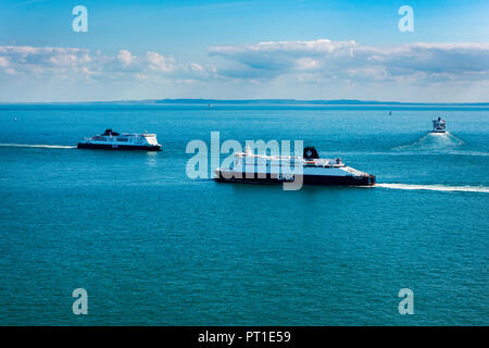 DOVER, UK - 25SEP2018: DFDS Ferry Delft Seaways bound for Dunquerke, passes the inbound Cote des Dunes just outside Dover Harbour. P&O Ferry, Spirit o - Stock Photo