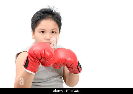 Handsome boy fighting with red boxing gloves isolated on white background, exercise and healthy concept - Stock Photo