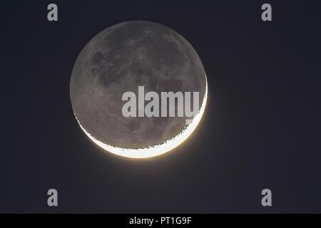 Germany, Hesse, Hochtaunuskreis, grey moon light and bright new moons crescent - Stock Photo