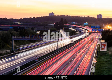 Germany, Baden-Wuerttemberg, Stuttgart, Autobahn A8 in the evening, light trails - Stock Photo