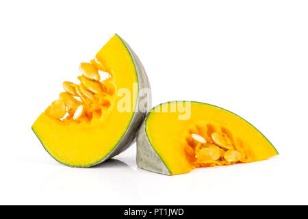 Group of two slices of fresh blue grey pumpkin nagy dobosi variety pieces with seeds isolated on white background - Stock Photo