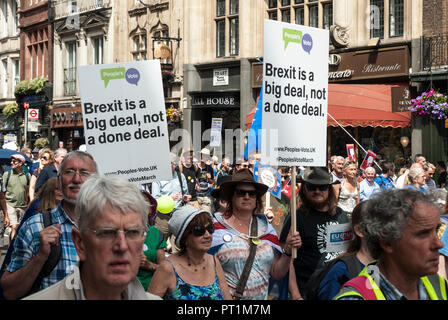 Wide shot showing rally with two official placards 'Peoples Vote. Brexit is a big deal, not a done deal' - Stock Photo