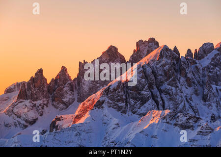 The red light of sunrise on the peaks of Pale di San Martino, Col margherita, San Pellegrino pass, Dolomites, Trentino, Italy, - Stock Photo