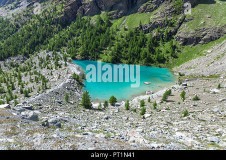 The green water of the Blu Lake at the foot of Monte Rosa Massif in Ayas Valley (Champoluc, Ayas Valley, Aosta province, Aosta Valley, Italy, Europe) - Stock Photo