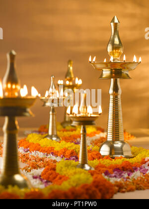 STILL LIFE OF BRASS DECORATIVE LAMPS  USED IN RELIGIOUS AND FESTIVALS IN INDIA - Stock Photo