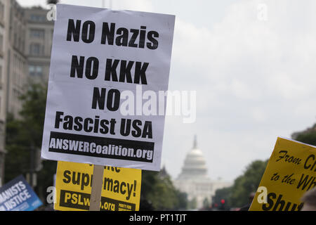 Charlottesville, Virginia, USA. 12th Aug, 2018. Counter protesters hold protest signs prior to the United The Right 2 Rally in Washington, DC on August 12, 2018. The Unite the Right Rally is a gathering of 'Alt-Right' demonstrators. Credit: Alex Edelman/ZUMA Wire/Alamy Live News - Stock Photo