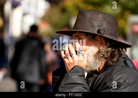 Dundee, Tayside, Scotland, UK. 5th October, 2018. Former X Factor 2017 audition contestant 'Fast Eddie' Lafferty is the harmonica playing busker and well known face on the streets of Dundee, Scotland. Eddie Lafferty has been playing the harmonica since he was 7 years old, nearly 50 years. This is Fast Eddie performing today and the streets are his stage. Credit: Dundee Photographics / Alamy Live News - Stock Photo