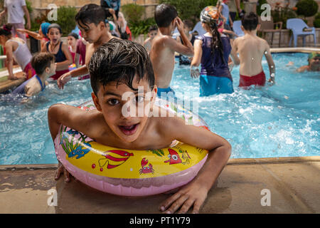 Bethlehem, Palestine. 15th Feb, 2018. Fuad seen enjoying his day at the swimming pool during the summer camp.The Return Summer Camp was organised for children of the Aida refugee camp, it was established in 1950 by the Palestinians who were expelled from their homes from 27 towns throughout Palestine, namely Nasra, Tabaria, Jerusalem, Acre, Jaffa, Haifa and Hebron. This is a 4th generation of refugees, 130 children ranging from 4 to 16 years of age being overlooked by 20 instructors and volunteers and it was funded by the UN until 2000. (Credit Image: © Enzo Tomasiello/SOPA Images via ZU - Stock Photo