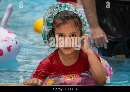 Bethlehem, Palestine. 15th Feb, 2018. Tala seen at the swimming pool during the summer camp.The Return Summer Camp was organised for children of the Aida refugee camp, it was established in 1950 by the Palestinians who were expelled from their homes from 27 towns throughout Palestine, namely Nasra, Tabaria, Jerusalem, Acre, Jaffa, Haifa and Hebron. This is a 4th generation of refugees, 130 children ranging from 4 to 16 years of age being overlooked by 20 instructors and volunteers and it was funded by the UN until 2000. Credit: Enzo Tomasiello/SOPA Images/ZUMA Wire/Alamy Live News - Stock Photo