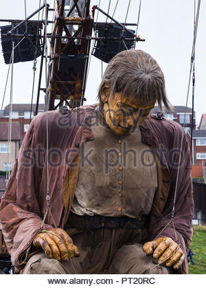 Brighton, UK. 05th Oct, 2018. Giant man sleeping by the promenade at New Brighton.  Captured on day one (Friday 5th October 2018) during Liverpool's Dream, the finale of the Royal De Luxe giants. Credit: Jason Wells/Alamy Live News - Stock Photo
