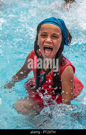 Bethlehem, Palestine. 16th Feb, 2018. Reem seen enjoying her day at the swimming pool during the summer camp.The Return Summer Camp was organised for children of the Aida refugee camp, it was established in 1950 by the Palestinians who were expelled from their homes from 27 towns throughout Palestine, namely Nasra, Tabaria, Jerusalem, Acre, Jaffa, Haifa and Hebron. This is a 4th generation of refugees, 130 children ranging from 4 to 16 years of age being overlooked by 20 instructors and volunteers and it was funded by the UN until 2000. (Credit Image: © Enzo Tomasiello/SOPA Images via ZU - Stock Photo