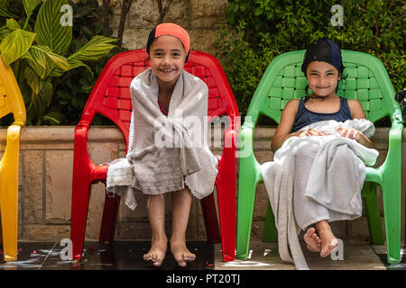 Bethlehem, Palestine. 15th Feb, 2018. Lojain and Joud seen at the swimming pool during the summer camp.The Return Summer Camp was organised for children of the Aida refugee camp, it was established in 1950 by the Palestinians who were expelled from their homes from 27 towns throughout Palestine, namely Nasra, Tabaria, Jerusalem, Acre, Jaffa, Haifa and Hebron. This is a 4th generation of refugees, 130 children ranging from 4 to 16 years of age being overlooked by 20 instructors and volunteers and it was funded by the UN until 2000. (Credit Image: © Enzo Tomasiello/SOPA Images via ZUMA Wir - Stock Photo