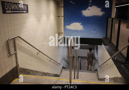 New York, USA. 05th Oct, 2018. A man walking down the steps of New York subway station 72nd Street. A new mosaic of the artist and widow of John Lennon has been inaugurated in the subway station under Yoko Ono's New York residence. Six parts of the Sky mosaic have been installed during renovation work on the walls of 72nd Street subway station on the Upper West Side in Manhattan. There are blue skies and clouds on it. Credit: Christina Horsten/dpa/Alamy Live News - Stock Photo