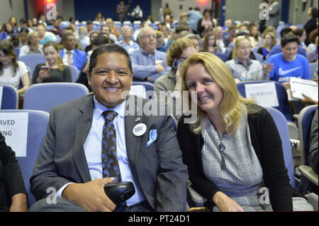 Hempstead, New York, USA. 5th Oct, 2018. L-R, Democrats JUAN VIDES, candidate for NYS 20th Assembly District, and DEBRA MULE, Nassau County Legislator for District 5, pose before start of Sen. Gillibrand's Town Hall Meeting at Hofstra University on Long Island. Credit: Ann Parry/ZUMA Wire/Alamy Live News - Stock Photo
