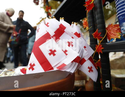 Moscow, Russia. 06th Oct, 2018. MOSCOW, RUSSIA - OCTOBER 6, 2018: Georgian flags at the annual 2018 Tbilisoba Festival of Georgian Culture at the Moscow Hermitage Garden. Artyom Geodakyan/TASS Credit: ITAR-TASS News Agency/Alamy Live News - Stock Photo
