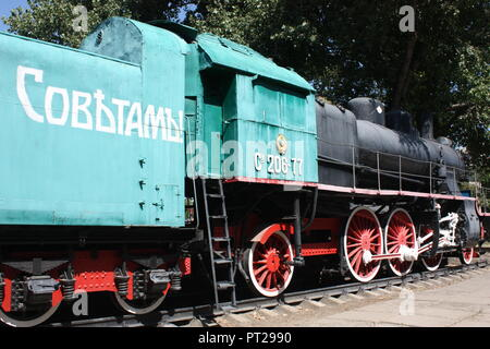 A steam train outside the station in Bendereh in Transdniestr - Stock Photo