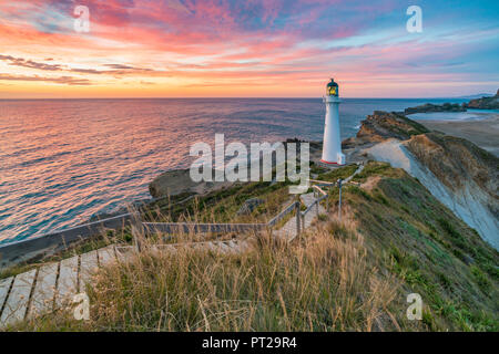 Castlepoint lighthouse at dawn, Castlepoint, Wairarapa region, North Island, New Zealand, - Stock Photo