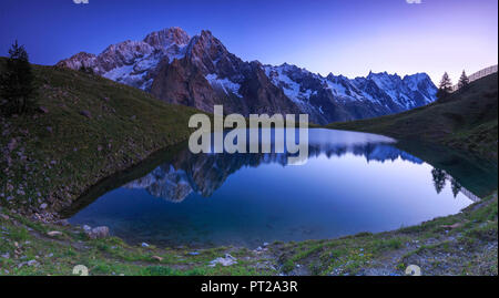 Mont Blanc mountain range is reflected in Lac Checrouit during dusk, Checrouit Lake, Veny Valley, Courmayeur, Aosta Valley, Italy, Europe - Stock Photo