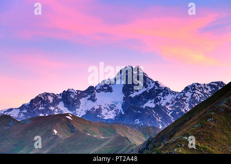 Colourful clouds above Mount Disgrazia during sunrise, Valtellina, Lombardy, Italy, Europe, - Stock Photo