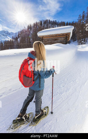 Young girl walk on the snow with snowshoes, Grevasalvas, Engadin Valley, Graubünden, Switzerland, Europe, - Stock Photo
