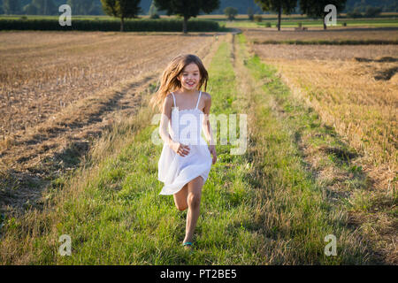 Happy little girl running in nature - Stock Photo