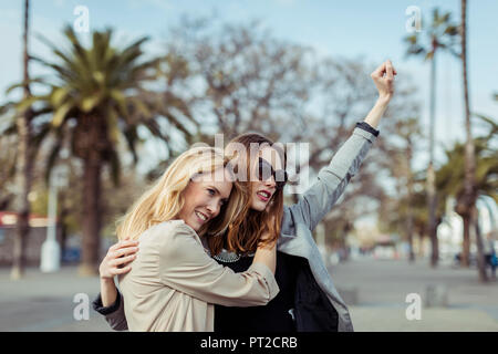Portrait of two fashionable young women - Stock Photo