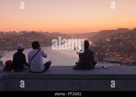 View from Vila Nova de Gaia to the Ribeira district at sunset, Porto, Norte, Portugal - Stock Photo