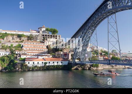 Rabelo Boat on the Douro, Serra do Pilar Monastery, Ponte Dom Luis I. Bridge (UNESCO World Heritage Site), Porto, Norte Region, Portugal - Stock Photo