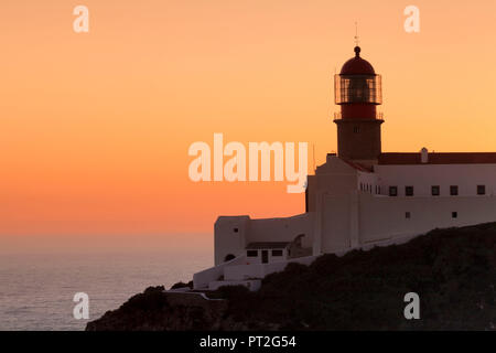 Lighthouse at Cabo de Sao Vicente at sunset, Sagres, Algarve, Portugal - Stock Photo