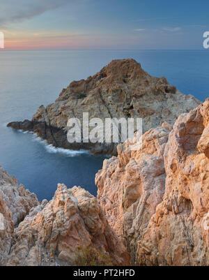 Rocky coast at L'Ile Rousse, Corsica, France - Stock Photo