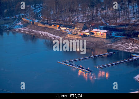 Cafe Solo in the evening light, winter weather, low water on Möhnesee, Sauerland - Stock Photo