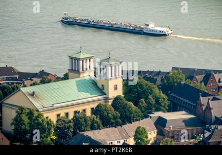 City church St. Mary of the Assumption with cargo ship on the Rhine at Rees, Rees, Lower Rhine, Rhine, North Rhine-Westphalia, Germany - Stock Photo