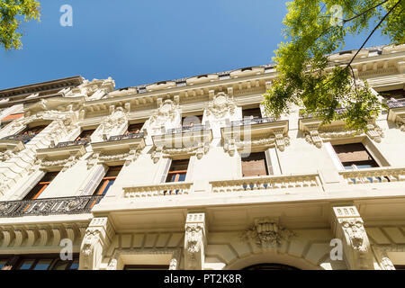 House facade, decorated with stucco, Madrid, Spain, urban architecture, close-up - Stock Photo