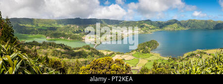 the lakes of Sete Cidades located in volcanic crater, twin lake blue and green, central bridge - Stock Photo
