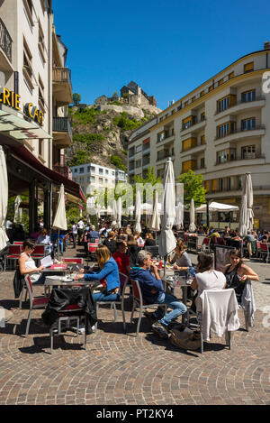 Switzerland, canton Valais, Rhone Valley, district Sion, Sion, Rue du Grand-Pont, people sitting in a cafe - Stock Photo