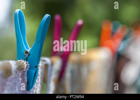 Colorful clothespegs with towels on a leash - Stock Photo