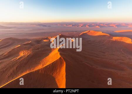 Africa, Namibia, Namib desert, Namib-Naukluft National Park, Aerial view of desert dunes in the morning light - Stock Photo