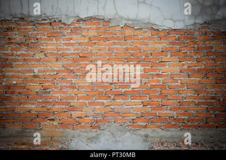 Unfinished brick wall plastering background with copy space. Under plastering brick wall texture as a creative background. - Stock Photo