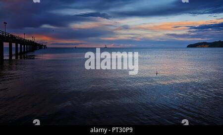 Pier of Binz at Ruegen Island under a storm cloud at night - Stock Photo