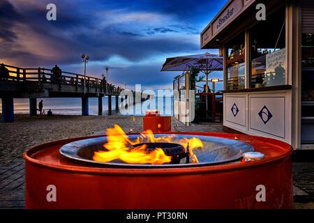 The promenade along the pier in Binz, Germany. - Stock Photo