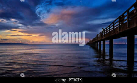 Old Pier of Binz at Ruegen Island under a storm cloud at night. Germany - Stock Photo