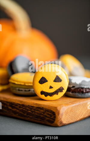 Halloween scary cookies with pumpkin on wooden cut board. pattern Bat , patina, ghosts and spiders. Gray color background, - Stock Photo