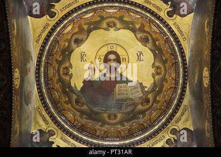 Jesus Christ depicted in the mural painting inside the dome of the Dormition Church on Vasilievsky Island in Saint Petersburg, Russia. The church designed by Russian architect Vasily Kosyakov with mural paintings by Russian painters Nikolay Strunnikov and others was built in 1895-1903. - Stock Photo
