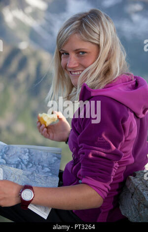 Young woman at Patteriol Peak, Verwall Group, Tyrol, Austria - Stock Photo