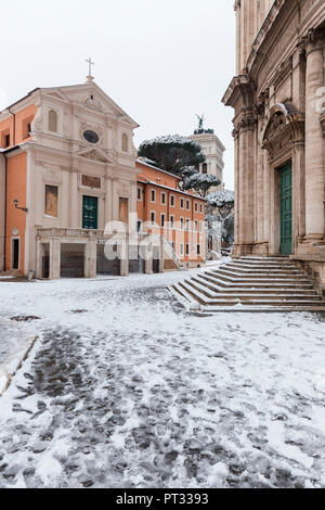 The Church of San Giuseppe dei Falegnami and Church of Santi Luca e Martina after the great snowfall of Rome in 2018 Europe, Italy, Lazio, Province of Rome, Rome - Stock Photo